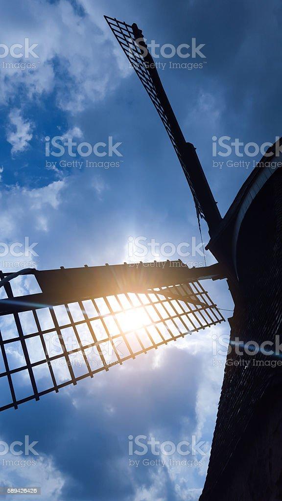 historic windmill wings in sunlight stock photo