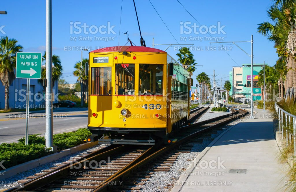 Historic yellow tram at Port of Tampa on a sunny day stock photo