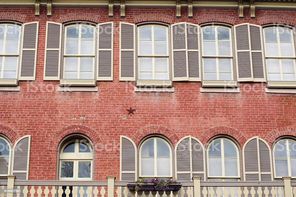 Historical brick building with shutters stock photo
