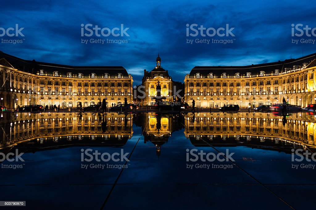 Historical building in Bordeaux reflected in a water pond stock photo