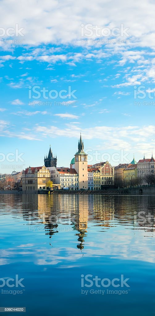 Historical buildings in Prague from across the river stock photo