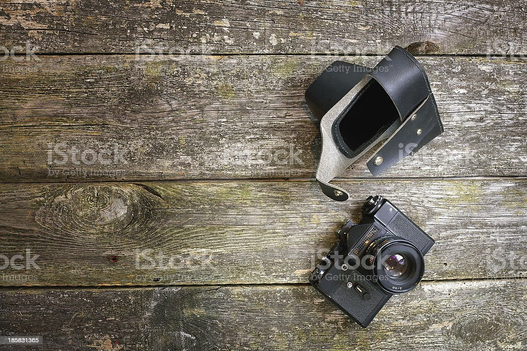 Historical camera on a wooden background royalty-free stock photo