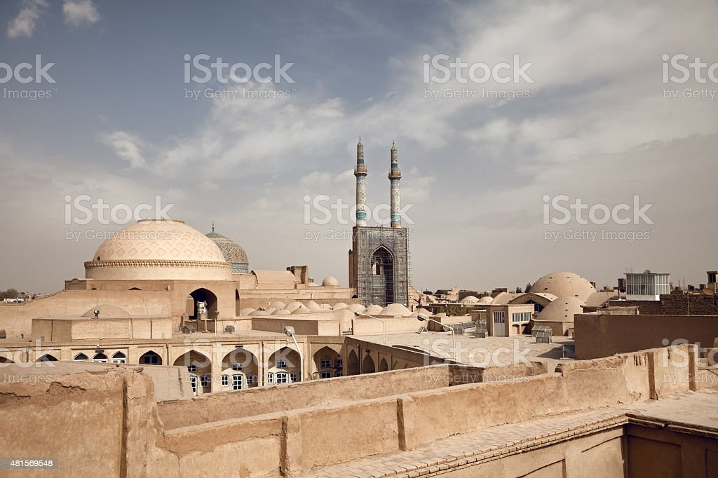 Historical City of Yazd with Traditional Buildings in its Skyline stock photo