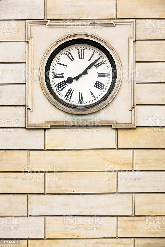 Historical clock in a wall stock photo