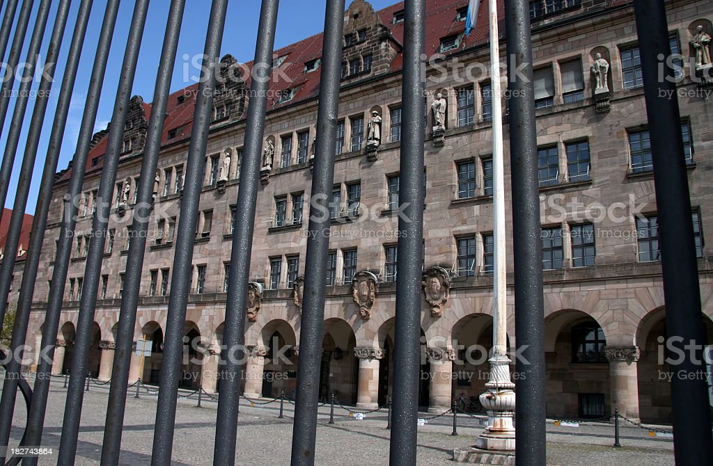 historical courthouse behind bars - The Nuremberg Trials stock photo