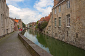 Historical gothic buildings by water channels at brugge belgium