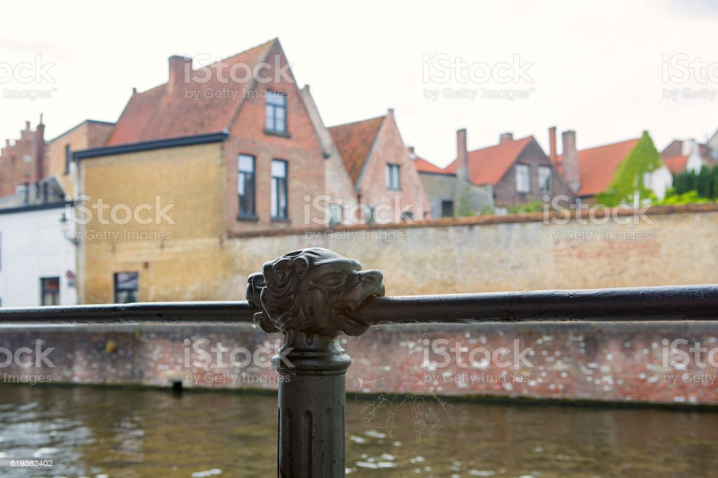historical iron handling bar with lionhead at brugge belgium stock photo