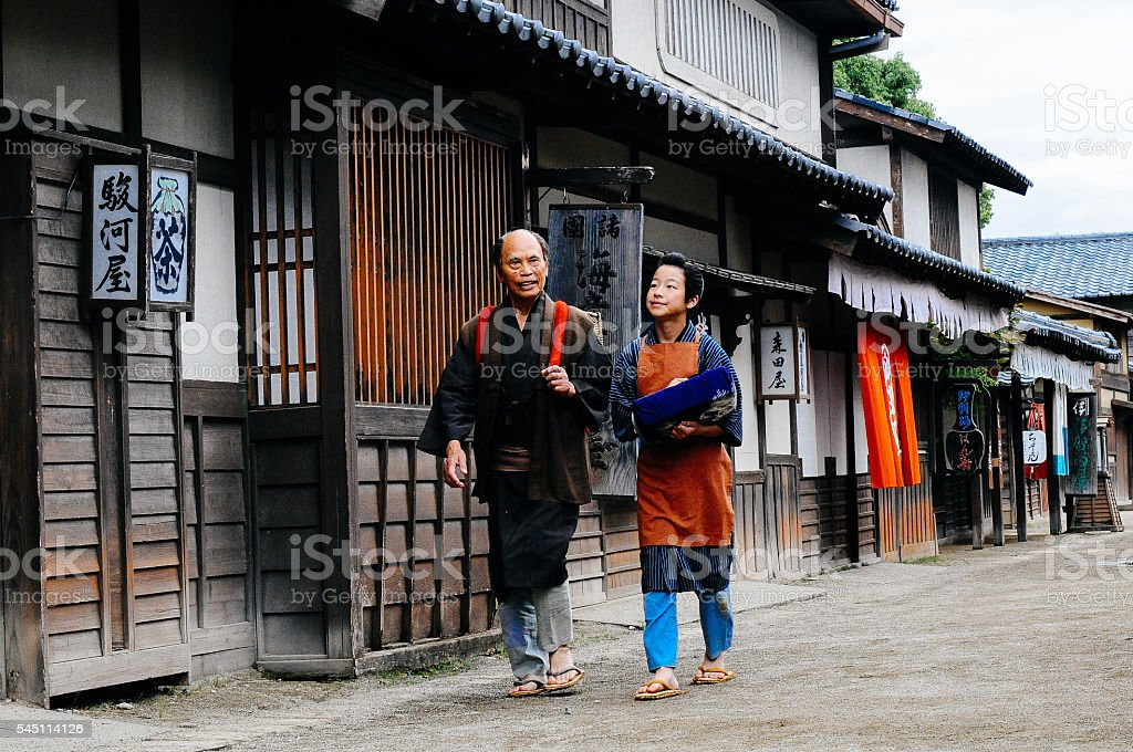 Historical Japanese village and father and son walking stock photo