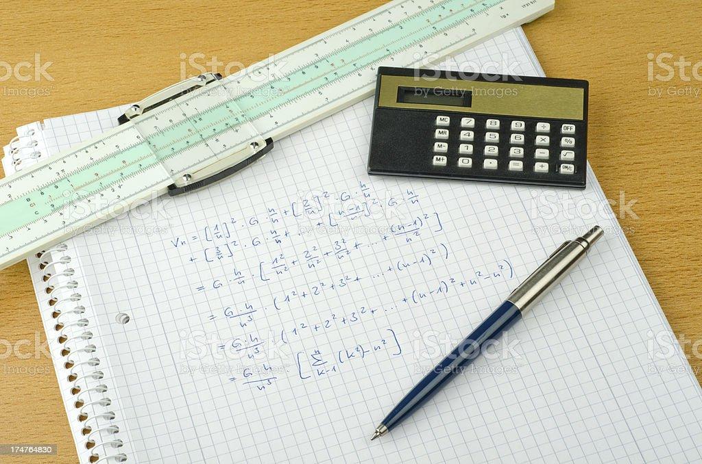 historical mathematics equipment with slideruler stock photo