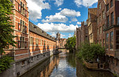 Historical old buildings by leie river at ghent belgium