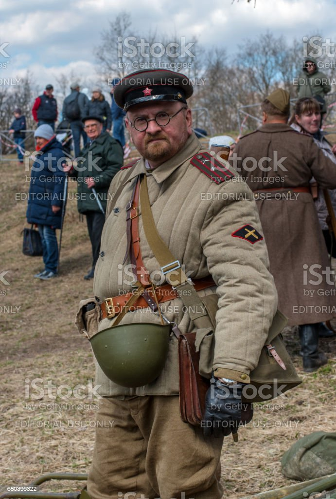 Historical reconstruction of the battles of World War II. A participant in the reconstruction in the form of a Soviet artillery officer. stock photo
