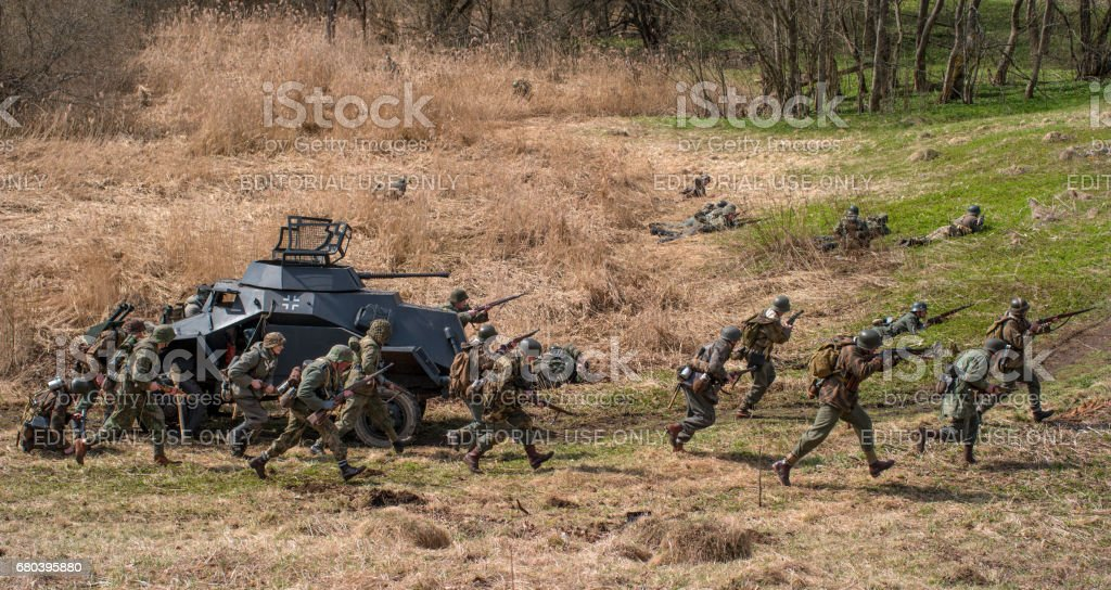 Historical reconstruction of the battles of World War II. Attack of the German soldiers. stock photo