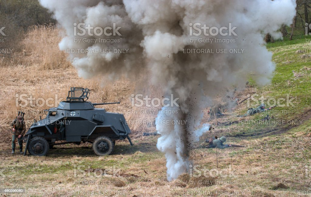 Historical reconstruction of the battles of World War II. Combat with an armored personnel carrier. stock photo