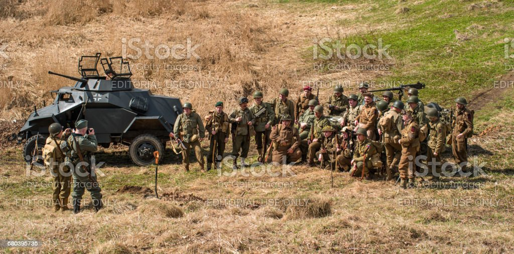 Historical reconstruction of the battles of World War II. Photographing combatants before the battle. stock photo