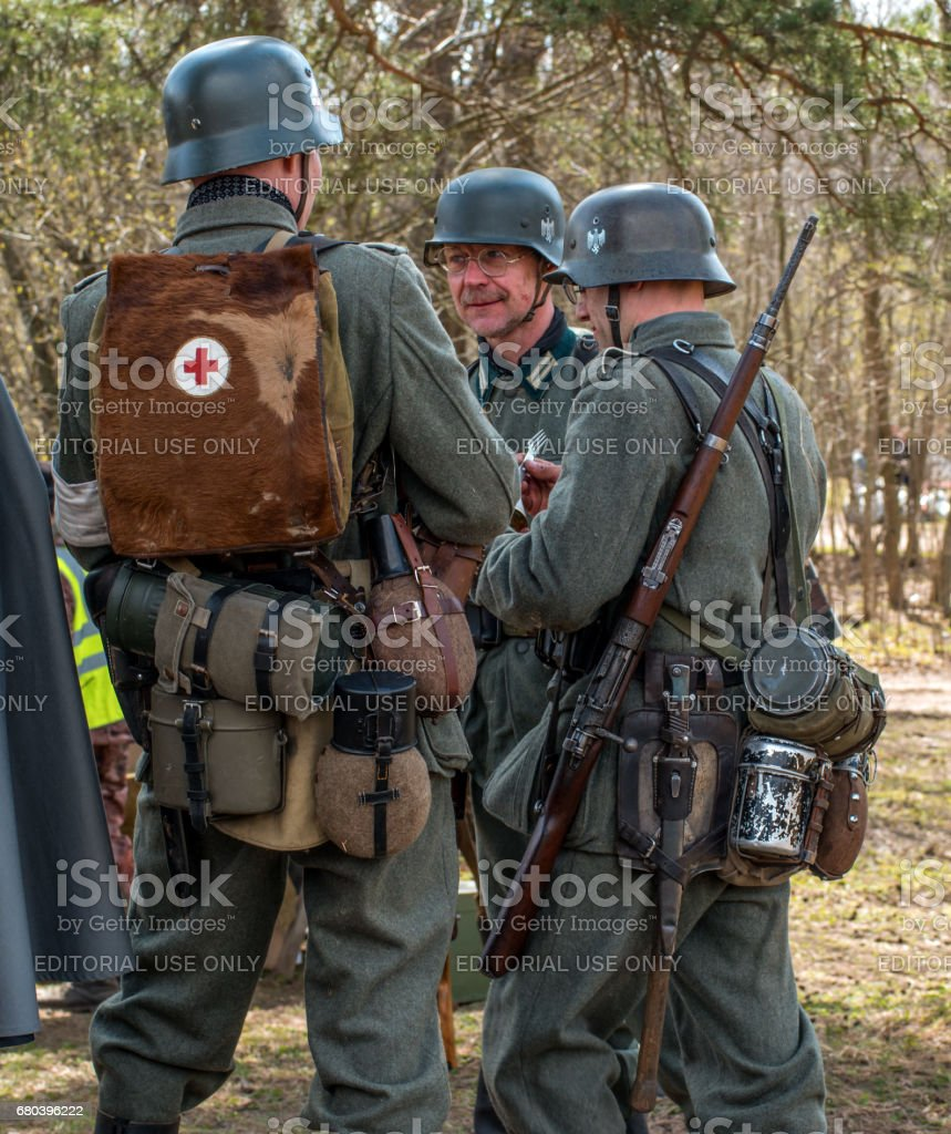 Historical reconstruction of the battles of World War II. German soldiers in full combat ammunition. stock photo