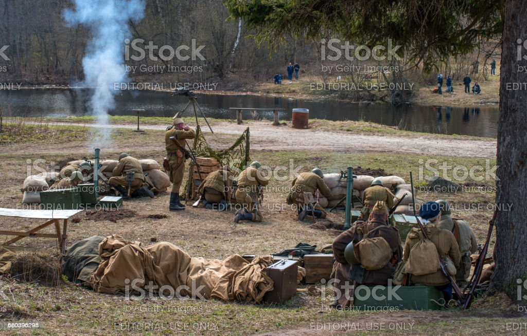 Historical reconstruction of the battles of World War II. Soldiers of the Red Army are firing mortars. stock photo