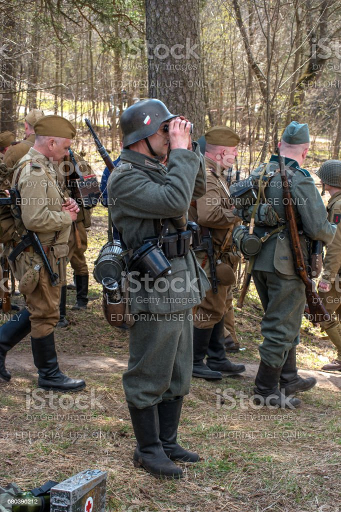 Historical reconstruction of the battles of World War II. Soviet and German soldiers before the battle. stock photo