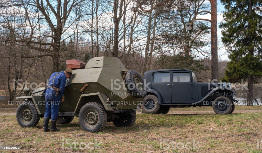 Historical reconstruction of the battles of World War II. Soviet armored car and passenger car Mercedes Benz. stock photo