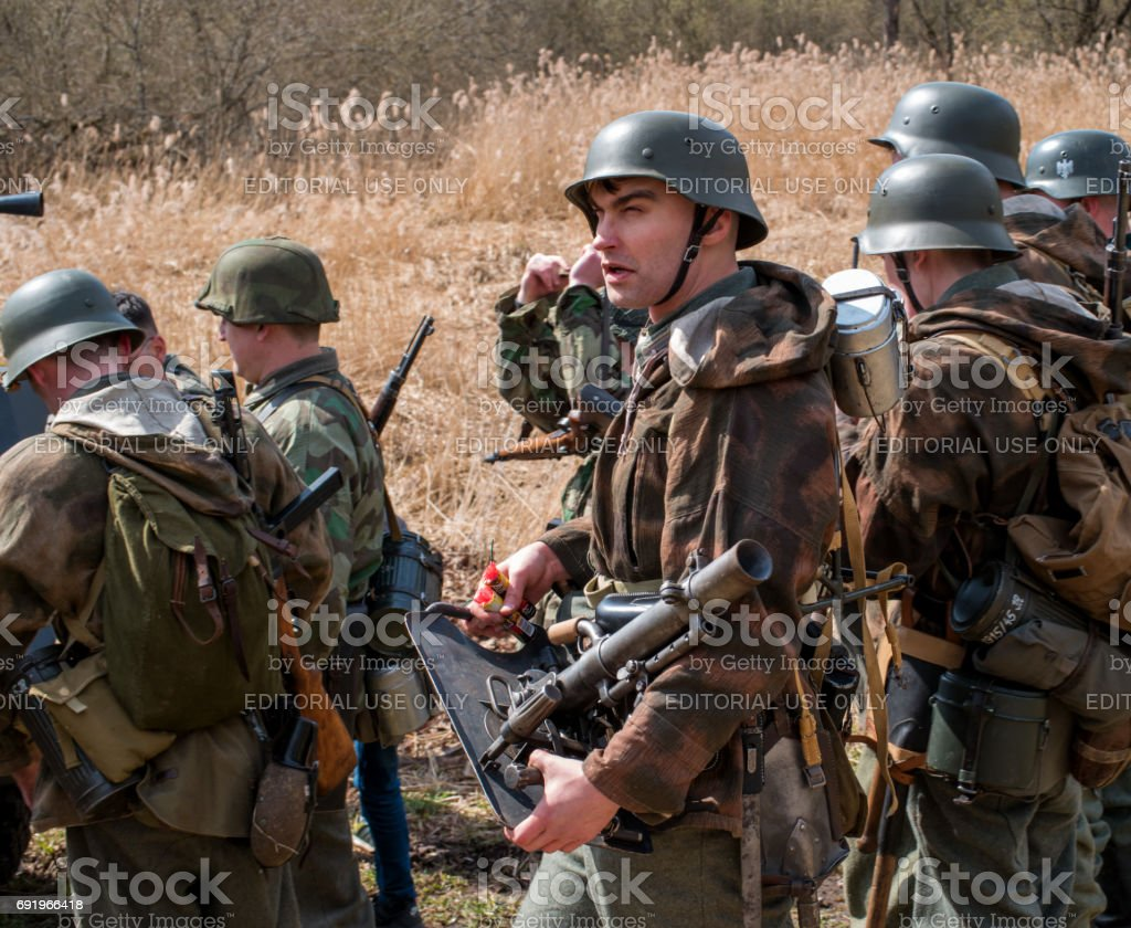 Historical reconstruction of the battles of World War II. The participants in the form of German soldiers preparing for battle. stock photo