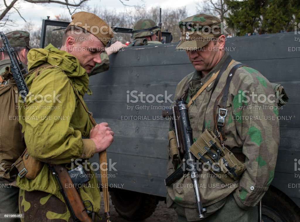 Historical reconstruction of the battles of World War II. The participants of the reconstruction in the form of Soviet and German armies. stock photo