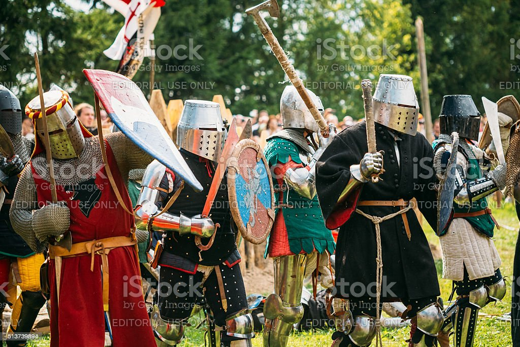 Historical restoration of knightly fights battle on festival of stock photo