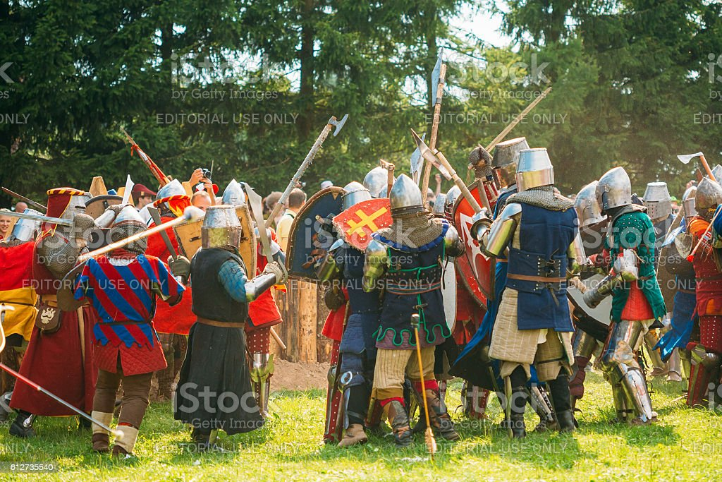 Historical restoration of knightly fights on festival of medieval culture stock photo