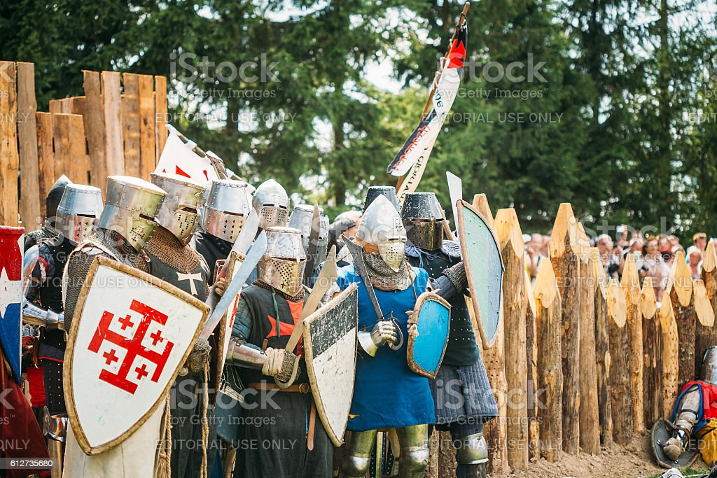Historical restoration of knightly fights. The siege of wooden fortress stock photo