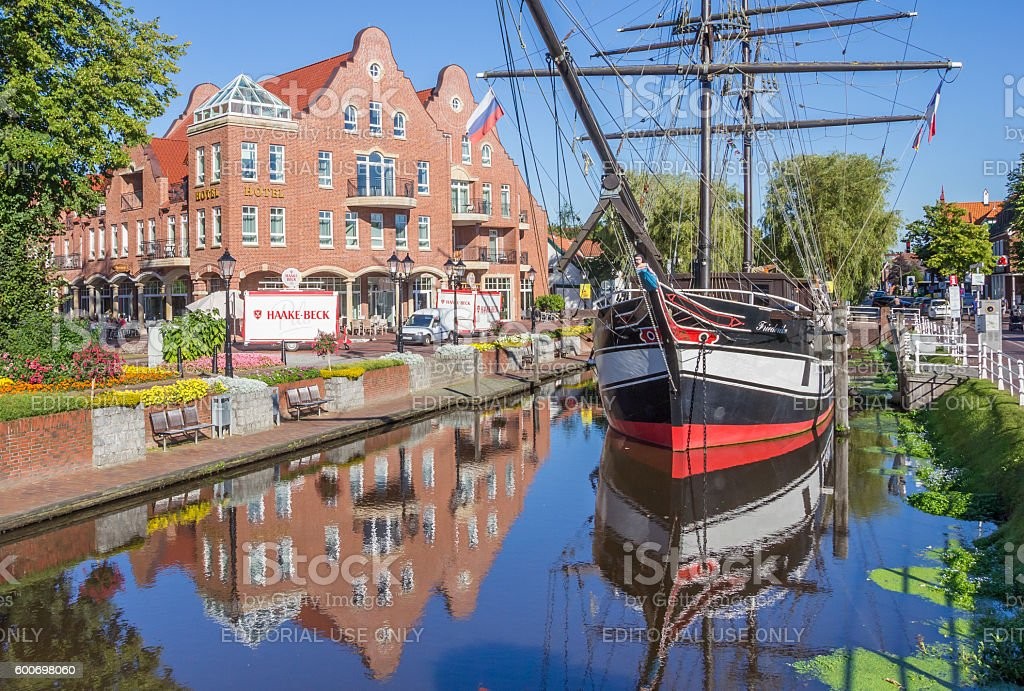 Historical ship in a canal in Papenburg stock photo