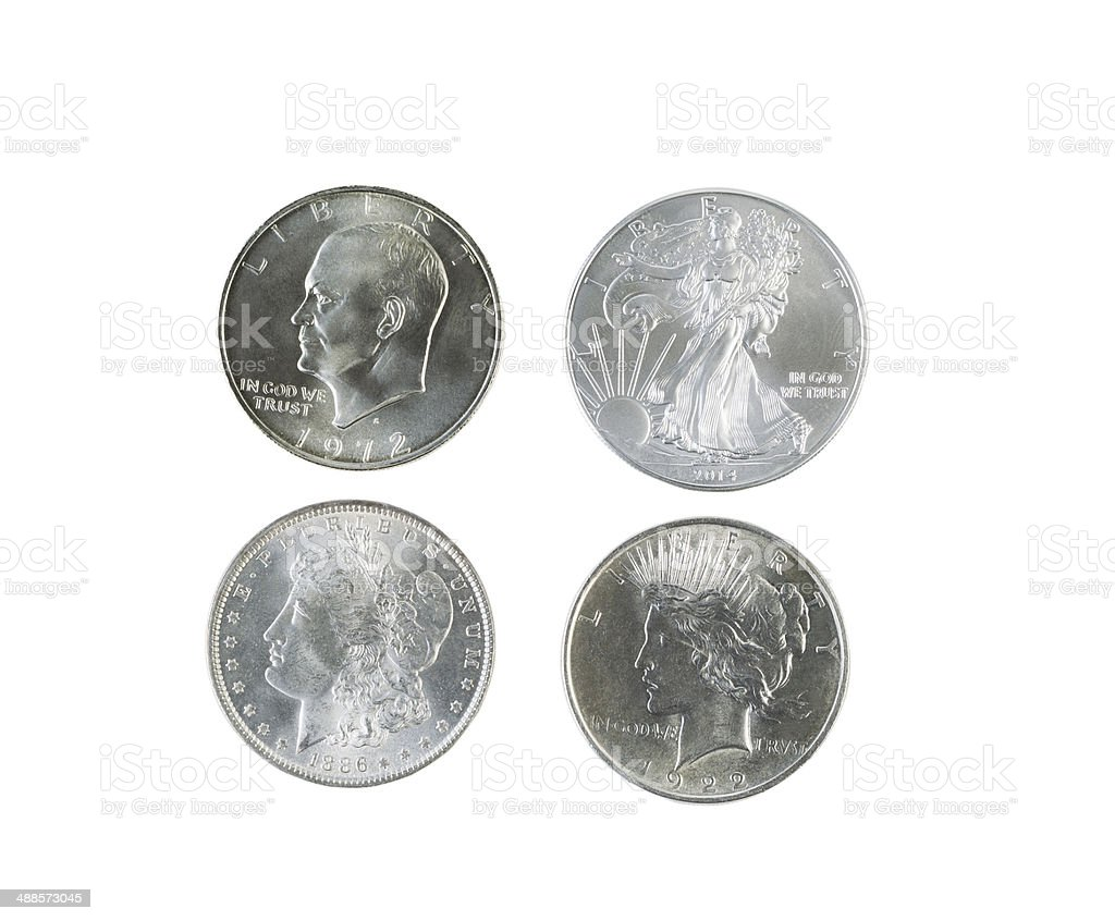 History of American Silver Dollars on White Background stock photo