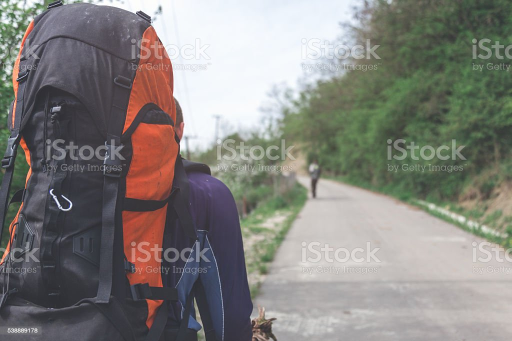 hitchhiker and backpack traveler . exploring countries stock photo