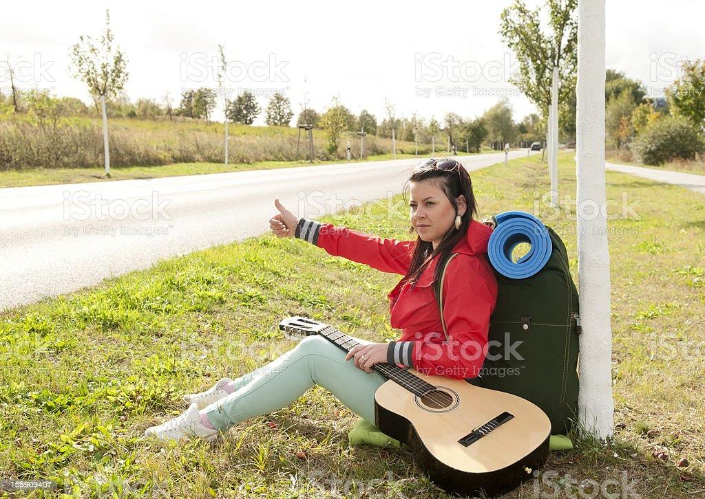 hitchhiker shows thumb up royalty-free stock photo