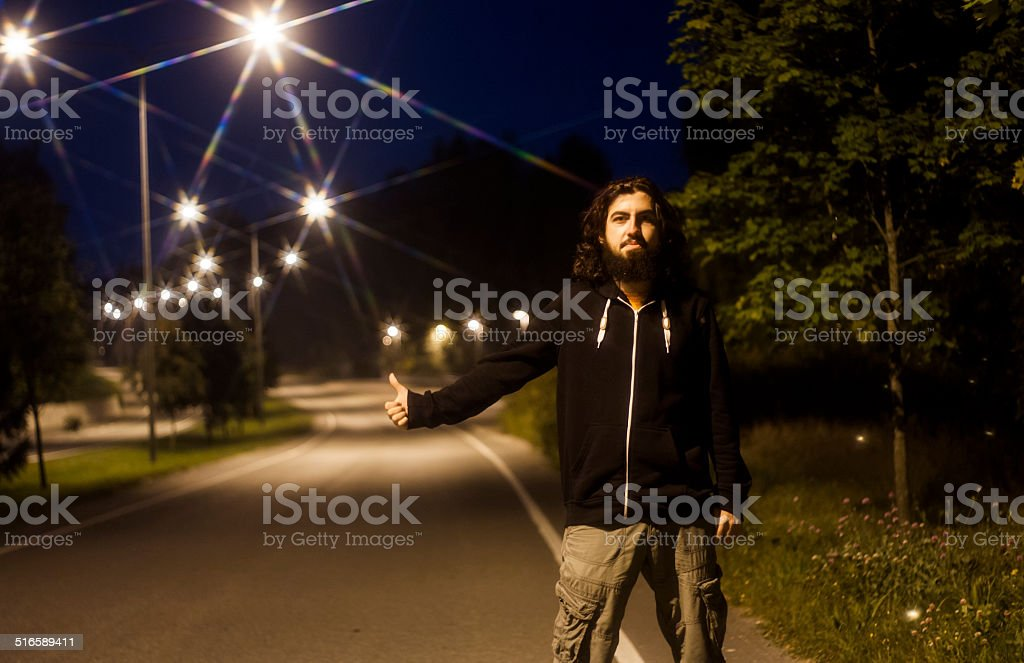 Hitch-hiking at night royalty-free stock photo