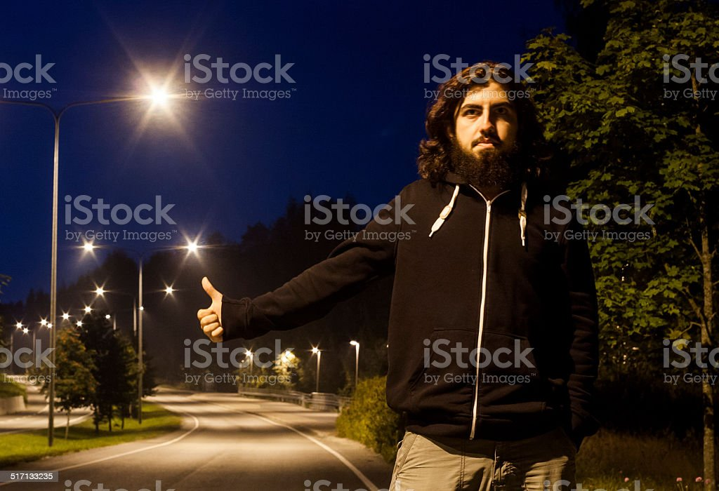 Hitch-hiking at night royalty-free stock photo