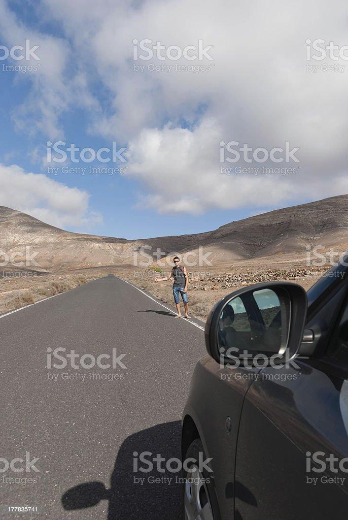 hitchhiking on desert road royalty-free stock photo