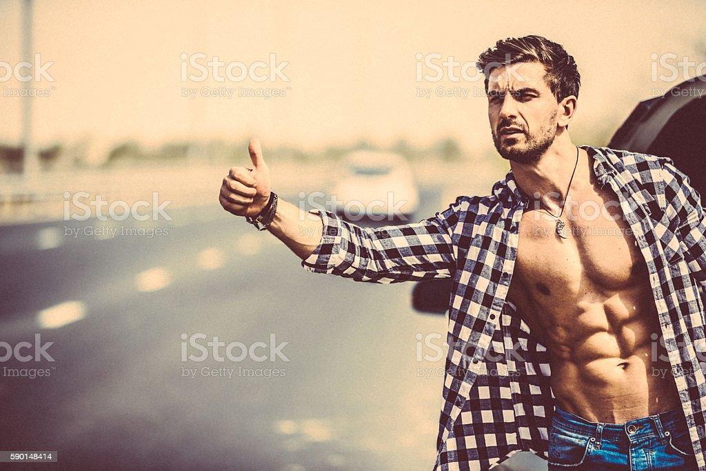 Hitchhiking or call it seeking some help. stock photo