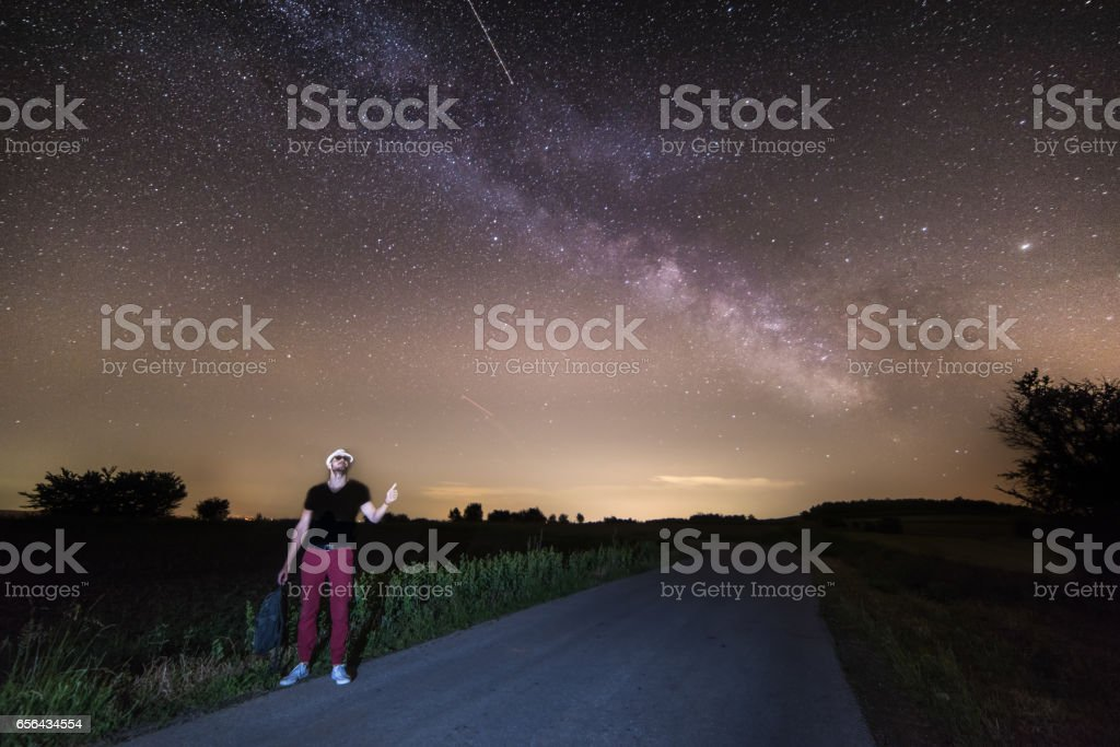Hitchhiking to Home Planet stock photo