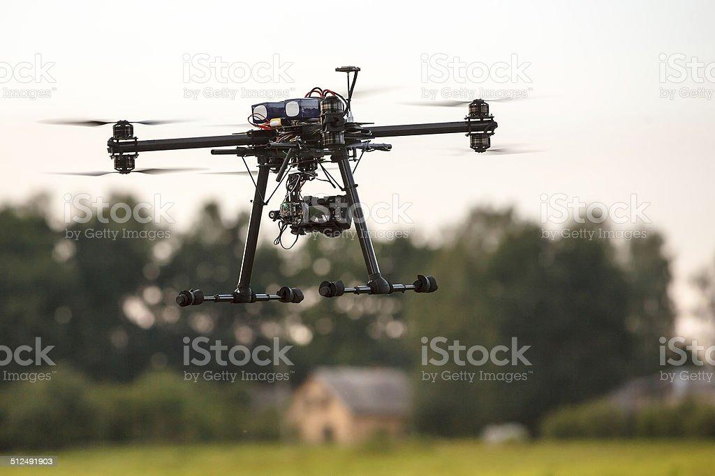 Hi-tech multicopter drone stock photo
