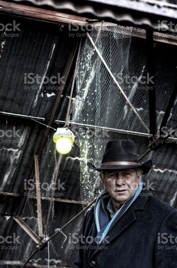 Hitman in old factory buidling stock photo
