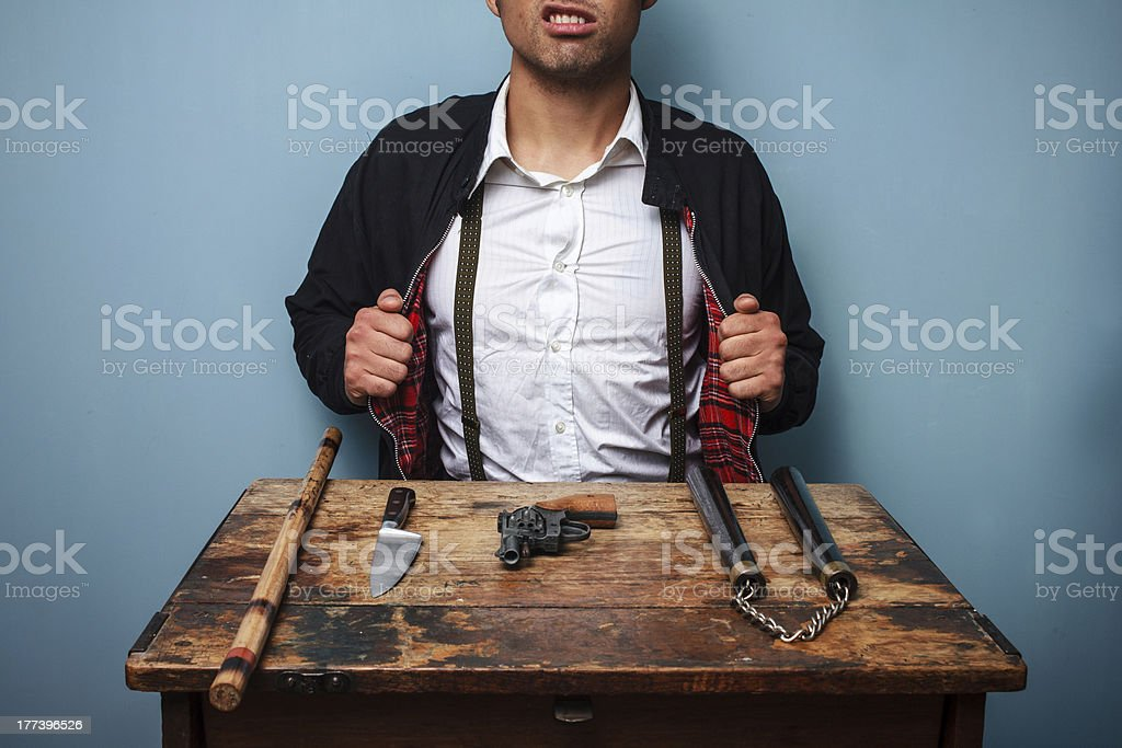 Hitman showing off his weapons royalty-free stock photo