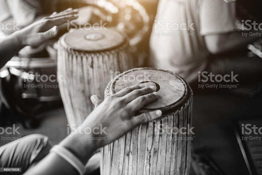 hitting drum musicians stock photo
