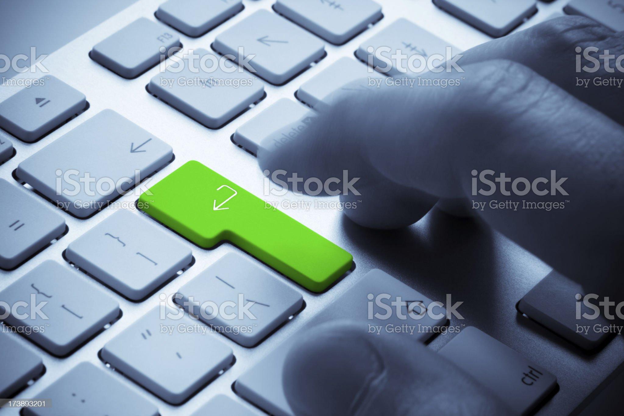 Hitting Green Enter Key royalty-free stock photo