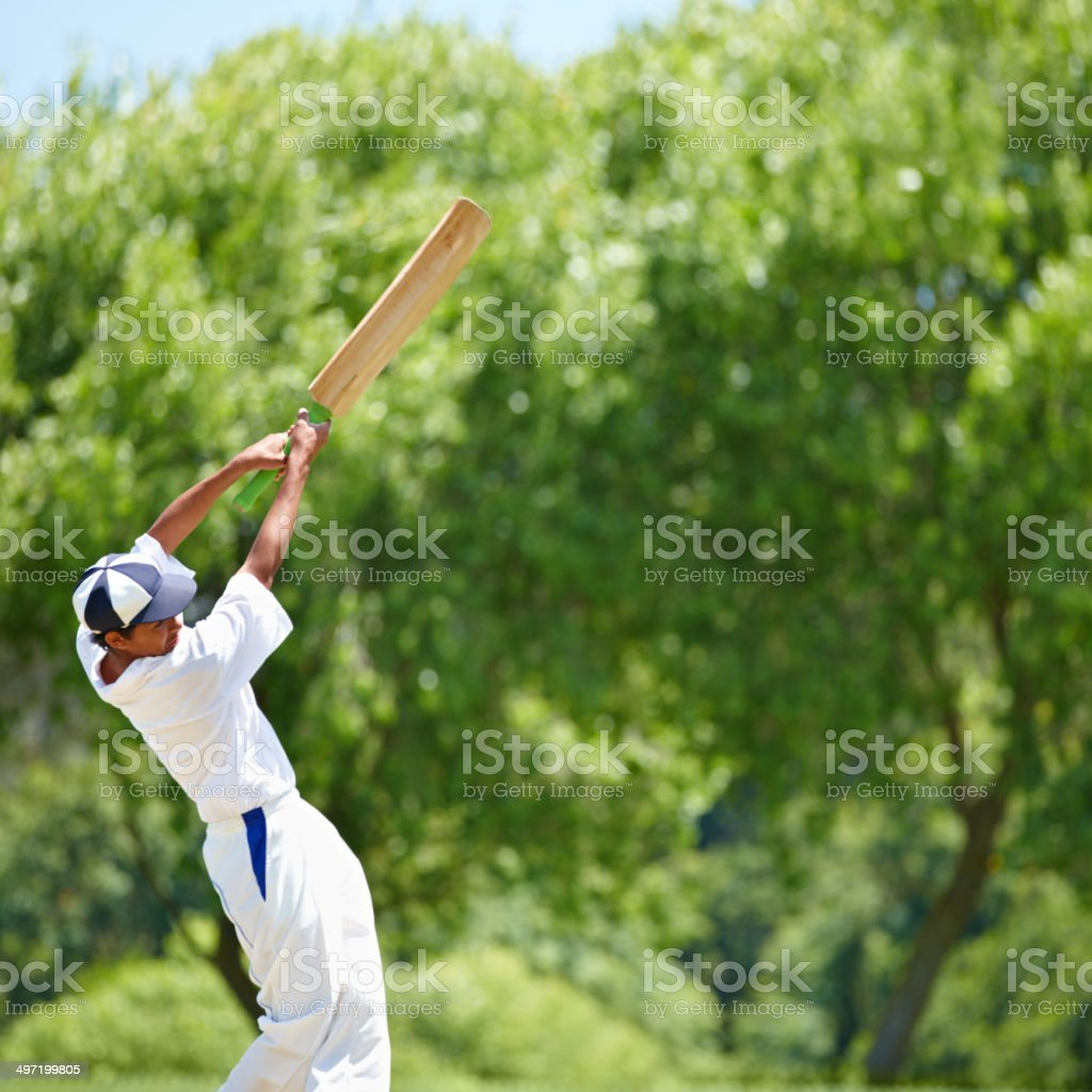 Hitting the ball with all his strength for victory royalty-free stock photo