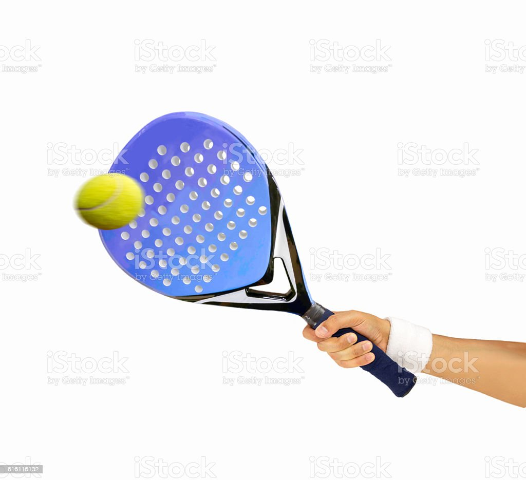 hitting the ball with paddle racquet stock photo