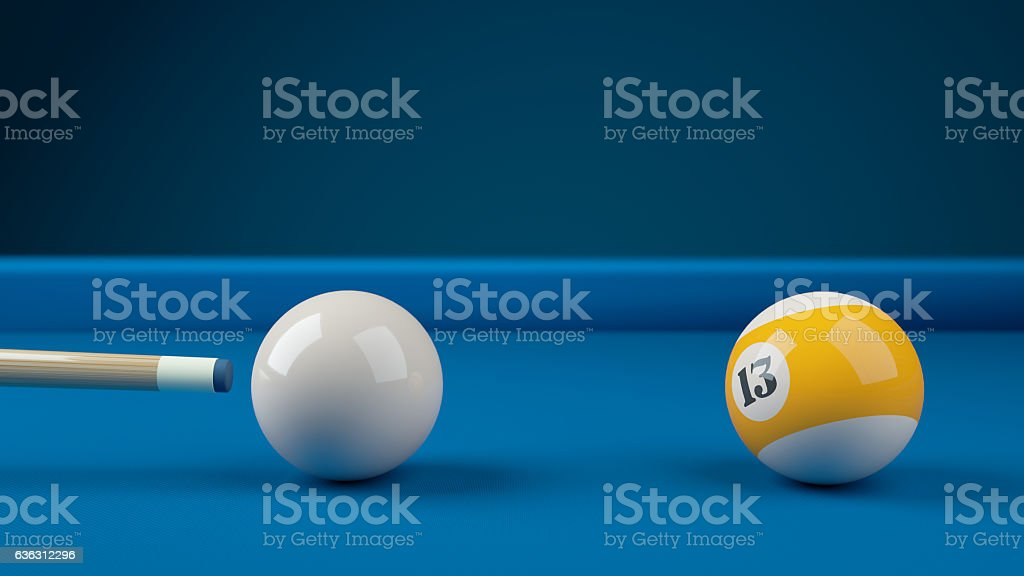 Hitting the cue ball number 13 on a blue billiard ball stock photo