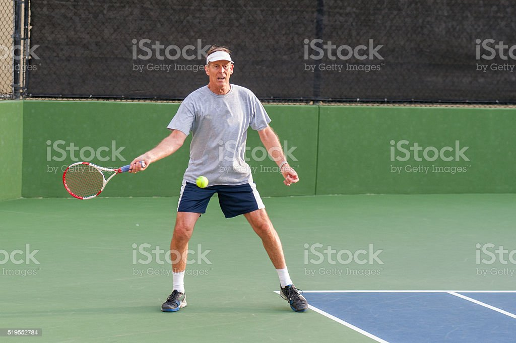 Hitting the open stance forehand stock photo