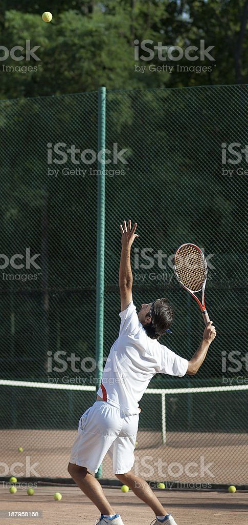 hitting the serve royalty-free stock photo