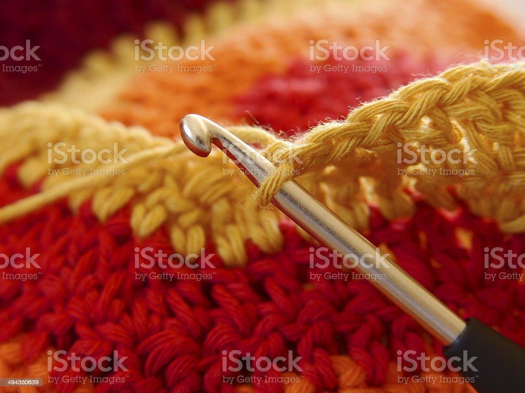 H?kelnadel in bunter Wolle stock photo