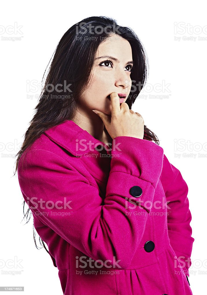 Hmmm, thoughtful young beauty in pink considers something seriously royalty-free stock photo
