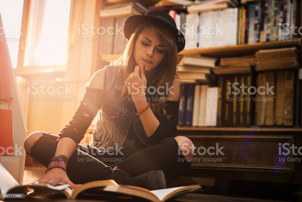 Hmmm, which book should I read? stock photo