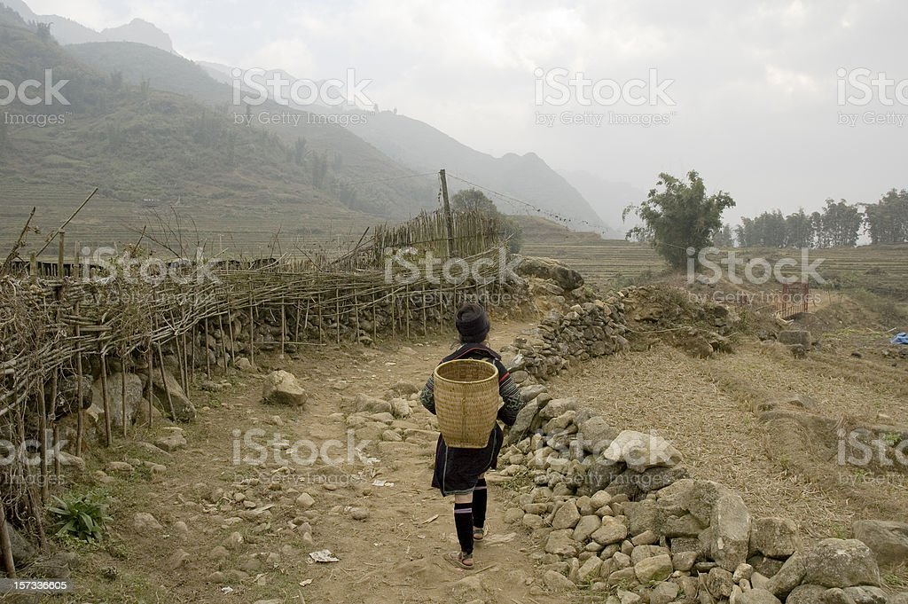 Hmong Woman Walking In The Hills Near Sapa, Vietnam stock photo